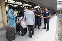 In this Sept.15, 2015 file photo, police officers check identity documents at the Saint-Charles train station, in Marseille, southern France. (AP Photo/Claude Paris)