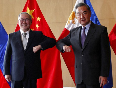 In this Jan. 16, 2021 file photo, Chinese Foreign Minister Wang Yi, right, and Philippine Foreign Affairs Secretary Teodoro Locsin Jr. bump their elbows during a meeting in Manila, Philippines. (Francis Malasig/Pool Photo via AP)