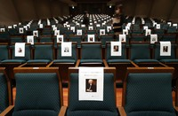 Portraits of composers, including Johann Sebastian Bach, are seen put up on seats to ensure audience members are spaced apart at Ueno Gakuen's Ishibashi Memorial Hall in Taito Ward, Tokyo, on Jan. 15, 2021. (Mainichi/Junichi Sasaki)