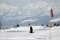 A snow golfer hits a shot toward an artificial grass green on a course set out on a snowfield in Bibai, Hokkaido Prefecture, on Jan. 23. (Mainichi/Taichi Kaizuka)