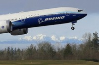 In this Jan. 25, 2020 file photo, a Boeing 777X airplane takes off on its first flight with the Olympic Mountains in the background at Paine Field in Everett, Washington. (AP Photo/Ted S. Warren)