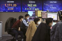 Currency traders watch monitors at the foreign exchange dealing room of the KEB Hana Bank headquarters in Seoul, South Korea, on Jan. 28, 2021. (AP Photo/Ahn Young-joon)