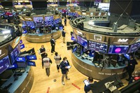 In this photo provided by the New York Stock Exchange, traders work on the floor, on Jan. 27, 2021. (Courtney Crow/New York Stock Exchange via AP)