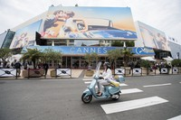 A scooter drives by the Palais des Festivals at the 71st international film festival in Cannes, southern France, on May 7, 2018. (Photo by Arthur Mola/Invision/AP)