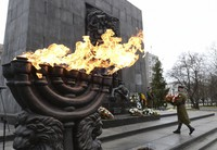 A wreath is laid at the monument to the Heroes of the Warsaw Ghetto in Warsaw, Poland, on Jan. 27, 2021, as part of world observances of the 76th anniversary of the liberation of the Nazi German death camp Auschwitz. (AP Photo/Czarek Sokolowski)