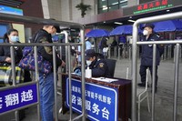 Travelers are screened before entering the Wuchang train station at the start of the annual Lunar New Year travel in Wuhan in central China's Hubei province on Jan. 28, 2021. (AP Photo/Ng Han Guan)