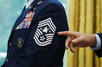 In this May 15, 2020, file photo, Chief Master Sgt. Roger Towberman displays his insignia during a presentation of the United States Space Force flag in the Oval Office of the White House in Washington. (AP Photo/Alex Brandon)
