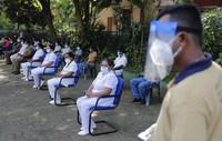 Sri Lankan health officials attend a mock COVID-19 vaccination drive in Piliyandala, Sri Lanka, on Jan. 23, 2021. (AP Photo/Eranga Jayawardena)