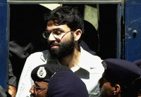 In this March 29, 2002 file photo, Ahmed Omar Saeed Sheikh, a British-Pakistani man accused in the 2002 killing of the American Wall Street Journal reporter Daniel Pearl appears at the court in Karachi, Pakistan. (AP Photo/Zia Mazhar)