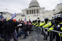 In this Jan. 6, 2021 file photo, Donald Trump supporters try to break through a police barrier at the Capitol in Washington. (AP Photo/Julio Cortez)