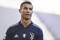 Juventus' Cristiano Ronaldo walks on the pitch during the Serie A soccer match between Juventus and Bologna, at the Allianz Stadium in Turin, Italy, on Jan. 24, 2021. (Fabio Ferrari/LaPresse via AP)