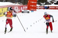 Jarl Magnus Riiber of Norway, left, and Akito Watabe of Japan compete on the finish line to win the men's Individual Gundersen NH 5km ski jumping competition at the Nordic Combined World Cup in the Austrian province of Tyrol, in Seefeld, Austria, on Jan. 29, 2021. (AP Photo/Matthias Schrader)