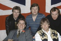 In this April 7, 1983 file photo, British pop group The Animals, from left, Hilton Valentine, Chas Chandler, John Steel, front row, Alan Price, and Eric Burdon, pose for photographers after announcing plans for a world tour, in London, England. (AP Photo)