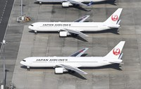 This Oct. 27, 2020 file photo shows JAL planes parked at Haneda Airport. (Mainichi)