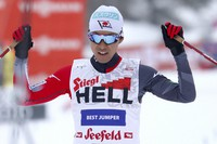 Third placed Akito Watabe of Japan celebrates as he crosses the finish line during the men's Individual Gundersen NH 15km triple competition at the Nordic Combined World Cup in the Austrian province of Tyrol, in Seefeld, Austria, on Jan. 31, 2021. (AP Photo/Matthias Schrader)
