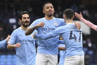 Manchester City's Gabriel Jesus, center, celebrates after scoring his side's opening goal during the English Premier League match between Manchester City and Sheffield United at the City of Manchester Stadium in Manchester, U.K., on Jan. 30, 2021. (Michael Regan/Pool via AP)