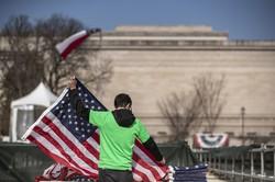 星条旗の下、団結できるか(Bloomberg)