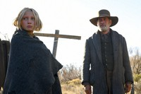 """This image released by Universal Pictures shows Helena Zengel, left, and Tom Hanks in a scene from """"News of the World."""" Zengel was nominated for a Golden Globe for best supporting actress in a motion picture on Feb. 3, 2021 for her role in the film. (Bruce W. Talamon/Universal Pictures via AP)"""