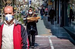 経済制裁とコロナで市民の不満は募るばかり(テヘラン) (Bloomberg)