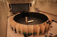 This Jan. 31, 2021 photo shows a circular stage set that is viewed by looking through a hole in the door of a room partitioned off for each person at Komaki Community Center in Aichi Prefecture. The paper tubes placed inside are used by the performers. (Photo courtesy of Ryosuke Sato)