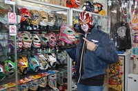 Mister Cacao shows off the colorful masks that adorn his shop in Takasaki, Gunma Prefecture, on Jan. 20, 2021. (Mainichi/Tetsuya Shoji)