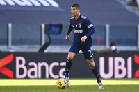Juventus' Cristiano Ronaldo goes for the ball during the Serie A soccer match between Juventus and Bologna, at the Allianz Stadium in Turin, Italy, on Jan. 24, 2021. (Fabio Ferrari/LaPresse via AP)