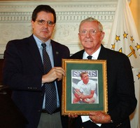 International Tennis Hall of Fame CEO Mark Stenning, left, presents Hall of Fame president and 1970 Hall of Famer Tony Trabert with a framed Sports Illustrated cover featuring Trabert after his French Open win, at the Statehouse in Providence, R.I., in this June 7, 2004, file photo. (AP)