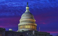 In the Nov. 6, 2020, file photo, shades of red and blue light of dawn fills the sky behind Capitol Hill in Washington. (AP Photo/J. Scott Applewhite)