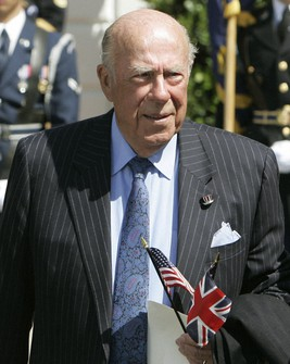 In this May 7, 2007 file photo, former Secretary of State George Schultz arrives to watch Queen Elizabeth II take part in arrival ceremonies on the South Lawn of the White House in Washington. (AP Photo/Ron Edmonds)