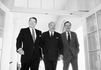 In this Jan. 9, 1985 file photo, Secretary of State George Shultz, center, walks with President Ronald Reagan and Vice President George Bush upon his arrival at the White House in Washington, after two days of arms talks with the Soviet Union in Geneva. (AP Photo/Barry Thumma)