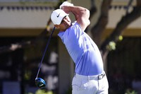 Brooks Koepka tees off on the fifth hole during the final round of a PGA golf tournament on Feb. 7, 2021, in Scottsdale, Ariz. (AP Photo/Rick Scuteri)