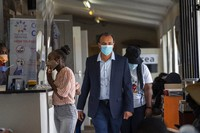 In this Nov. 30, 2020 file photo, Shabir Madhi, Professor of Vaccinology at the University of Witwatersrand, walks through a COVID-19 vaccine trial facility set at Soweto's Chris Sani Baragwanath Hospital outside Johannesburg. (AP Photo/Jerome Delay)
