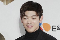 In this Dec. 2, 2016 file photo, South Korean-American singer-songwriter Eric Nam, poses for the photographers on the red carpet of the 2016 Mnet Asian Music Awards (MAMA) in Hong Kong. (AP Photo/Kin Cheung)