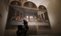 """A TV crew films Leonardo da Vinci's painting """"Last Supper,"""" dating to 1494-1498 and housed inside the refectory of the Convent of Santa Maria delle Grazie, in Milan, Italy, on Feb. 9, 2021. (AP Photo/Antonio Calanni)"""