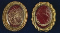 This undated photo released by RR Auction shows locks of hair from the heads of the first United States President George Washington, right, and from his wife Martha, left, up for auction between Feb. 11-18, 2021, by the Boston-based auction firm. (Nikki Brickett/RR Auction via AP)