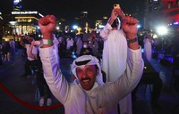 Emiratis celebrate after the Hope Probe enters Mars orbit as a part of Emirates Mars mission, in Dubai, United Arab Emirates, on Feb. 9, 2021. (AP Photo/Kamran Jebreili)