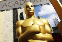 In this Feb. 21, 2015 file photo, an Oscar statue appears outside the Dolby Theatre for the 87th Academy Awards in Los Angeles. (Photo by Matt Sayles/Invision/AP)