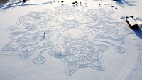 A giant complex geometric pattern formed from thousands of footsteps in the snow near to the capital Helsinki, in Espoo, Finland, is seen on Feb. 7, 2021.  (Janne Pyykko via AP)