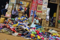A trader sells plastic shoes on a street in Butembo, where the first Ebola death was recorded, in the North Kivu province of Congo on Feb. 11, 2021. (AP Photo/Al-hadji Kudra Maliro)