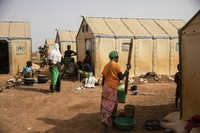 Displaced women prepare food Monday Feb. 8, 2021 in the Kaya camp, 100 kms North of Ouagadougou, Burkina Faso. (AP Photo/Sophie Garcia)