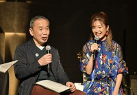 In this photo provided by TOKYO FM, Japanese author Haruki Murakami, left, talks with guitarist Kaori Muraji during a show in Tokyo on Feb. 14, 2021. (TOKYO FM via AP)