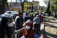 People over age 60 wait to get the AstraZeneca vaccine for COVID-19 as Mexico begins vaccinating its elderly population for the new coronavirus, in the outlying Milpa Alta borough of Mexico City, on Feb. 15, 2021. (AP Photo/Rebecca Blackwell)