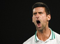 Serbia's Novak Djokovic celebrates after winning the second set against Russia's Aslan Karatsev during their semifinal match at the Australian Open tennis championship in Melbourne, Australia, on Feb. 18, 2021.(AP Photo/Andy Brownbill)