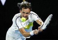 Russia's Daniil Medvedev hits a backhand return to Greece's Stefanos Tsitsipas during their semifinal match at the Australian Open tennis championship in Melbourne, Australia, on Feb. 19, 2021.(AP Photo/Andy Brownbill)