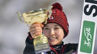 Japan's Sara Takanashi smiles as she holds her trophy after coming first at a women's Ski Jumping World Cup event in Rasnov, Romania, on Feb. 19, 2021. (AP Photo/Raed Krishan)