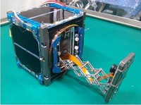 The miniature satellite which will attempt to take a selfie in space is seen with its camera arm extended in this image provided by Ryman Sat Project.
