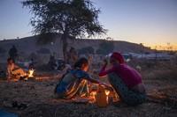 In this Dec. 11, 2020 file photo, Tigrinyan refugee women prepare bread for their family in Umm Rakouba refugee camp in Qadarif, eastern Sudan. (AP Photo/Nariman El-Mofty)