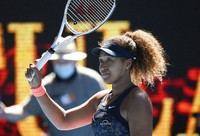 Japan's Naomi Osaka celebrates after defeating United States' Serena Williams in their semifinal match at the Australian Open tennis championship in Melbourne, Australia, on Feb. 18, 2021.(AP Photo/Andy Brownbill)