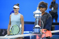 Japan's Naomi Osaka, right, stands with United States' Jennifer Brady ahead of the women's singles final at the Australian Open tennis championship in Melbourne, Australia, on Feb. 20, 2021.(AP Photo/Andy Brownbill)