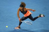 Japan's Naomi Osaka hits a forehand return to United States' Jennifer Brady during the women's singles final at the Australian Open tennis championship in Melbourne, Australia, on Feb. 20, 2021.(AP Photo/Hamish Blair)